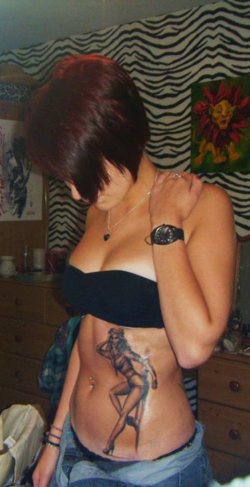 Hot Girl With Pin Up Tattoo On Stomach