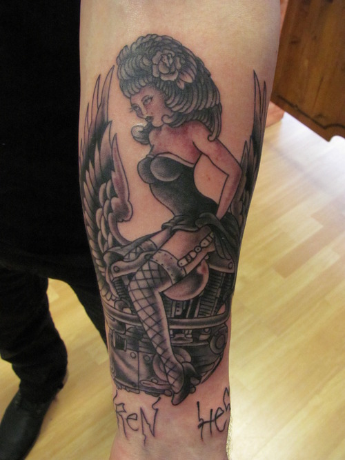 Hot Pin Up Girl On Bike Tattoo