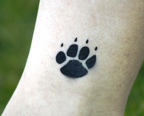 Impressive Black Paw Print Tattoo