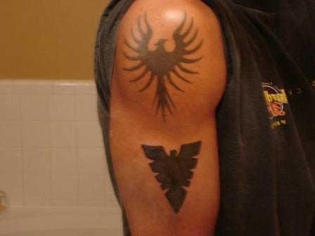 Impressive Black Phoenix Tattoo On Shoulder
