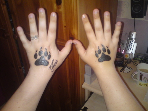 Impressive Dark Black Paw Tattoos On Hands