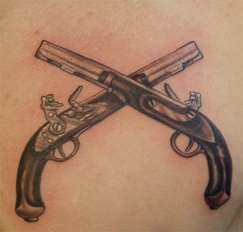 Impressive Twin Crossed Flintlock Pistol Tattoos