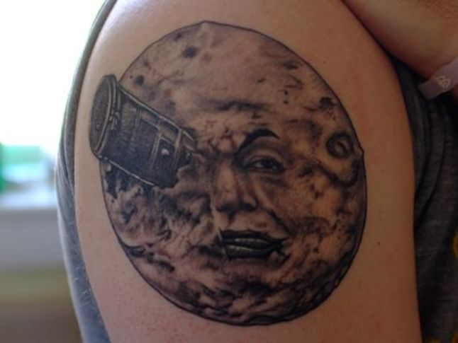 Incredible Grey Full Moon Tattoo On Biceps
