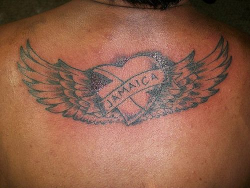 Jamaica Heart With Wings Tattoos On Upperback