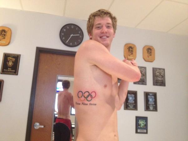 James Feigen's Show Off His Olympic Tattoo