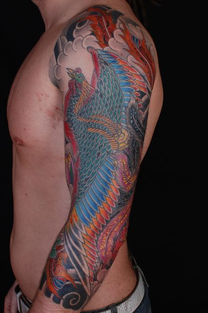 Large Colorful Phoenix And Clouds Tattoos On Sleeve