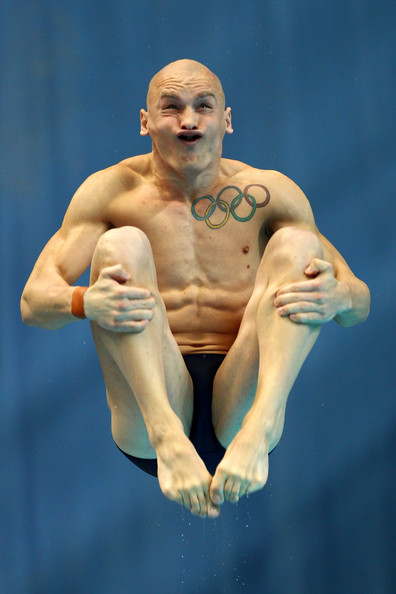 Large Olympic Tattoo On Chest Of Diver