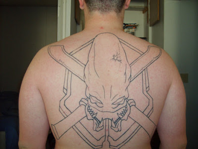 Large Outline Halo Tattoo On The Backbody