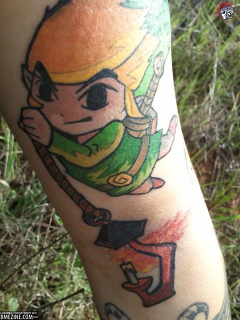 Link Swinging With Rope Tattoo On Arm