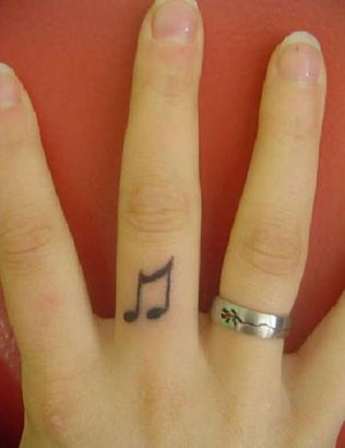 Little Black Music Symbol Tattoo On Finger