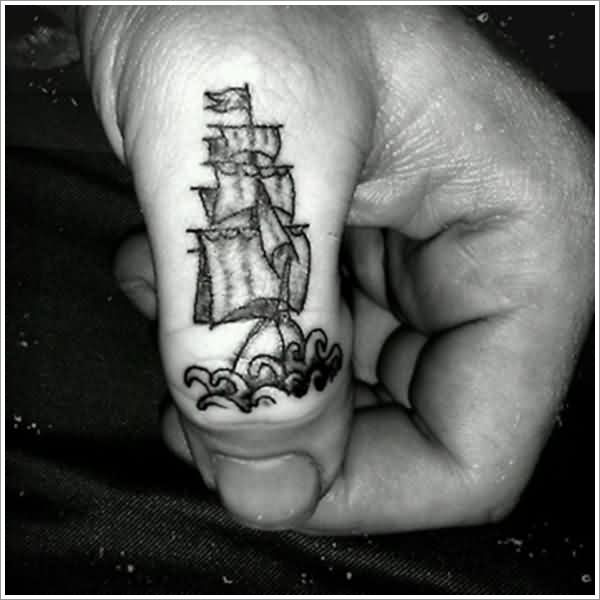 Little Grey Pirate Ship Tattoo On Thumb