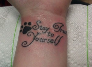 Little Heart Paw Print And Quote Tattoos On Inner Wrist