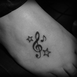 Little Stars And Musical Symbol Tattoos On Foot