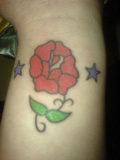 Little Stars And Red Rose Tattoos On Wrist