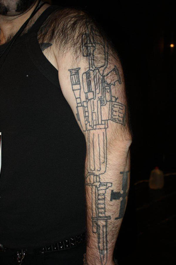 Long Outline Machine Gun Tattoo On Arm
