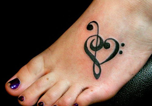 Lovely Black Love Symbol Tattoo On Foot