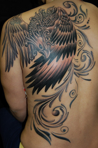 Lovely Feminine Phoenix Tattoo On Back