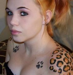 Lovely Girl With Paw And Leopard Print Tattoos