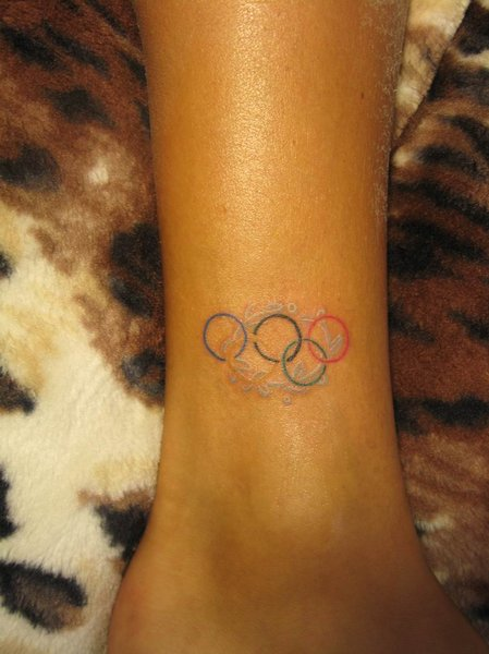 Lovely Olympic Rings Tattoo Above Ankle