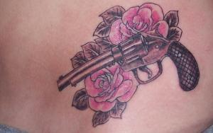 Lovely Pink Roses And Pistol Tattoos