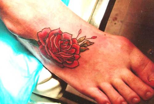 Lovely Red Rose Tattoo On Foot