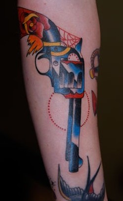 Lovely Rose Pistol And Spiderweb Tattoos On Arm