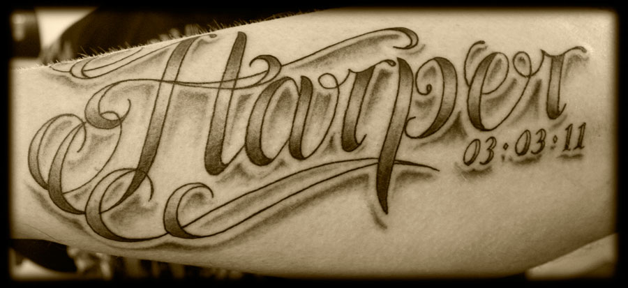 Lowrider Style Lettering Tattoo On Inner Arm