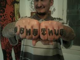 Man Showing Thug Life Knucle Tattoo