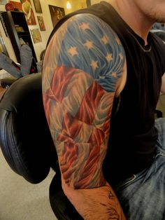 Man With Patriotic Tattoo On Right Half Sleeve