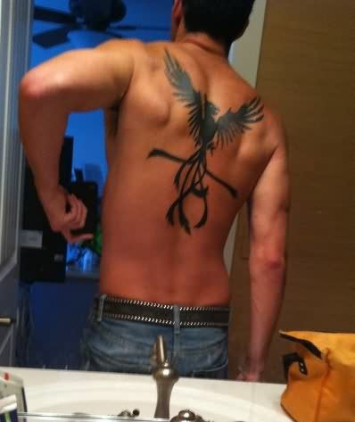 Man With The Tribal Phoenix Tattoo On Back