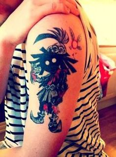 Masked Video Game Character Tattoo On Biceps
