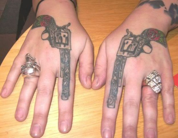 Matching Rose Pistol Tattoos On Both Hands