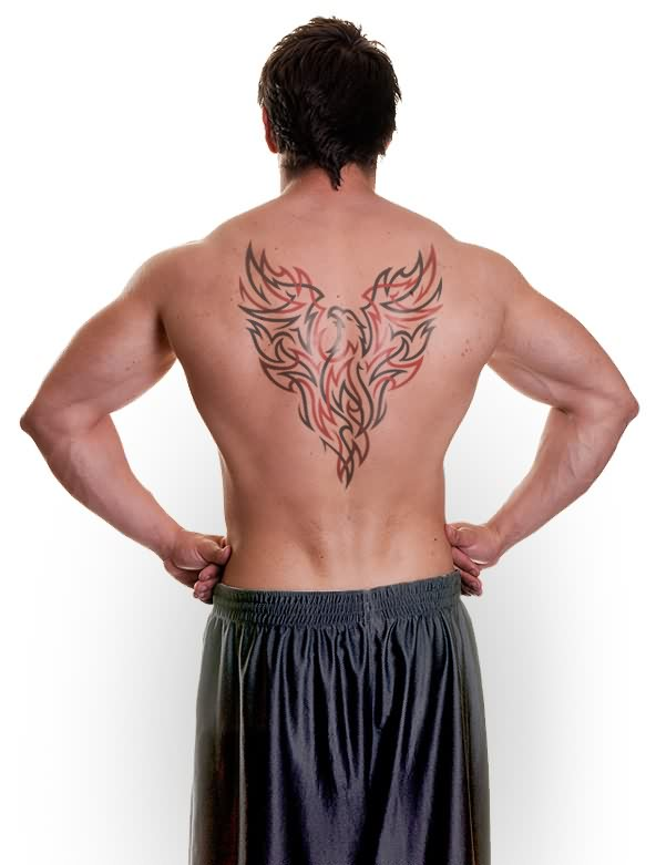 Model With The Tribal Phoenix Tattoo On Back