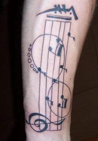 Musical And Infinity Symbol Tattoos On Arm