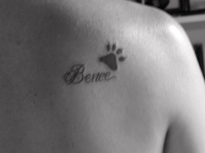Name With Paw Print Tattoo Behind Shoulder