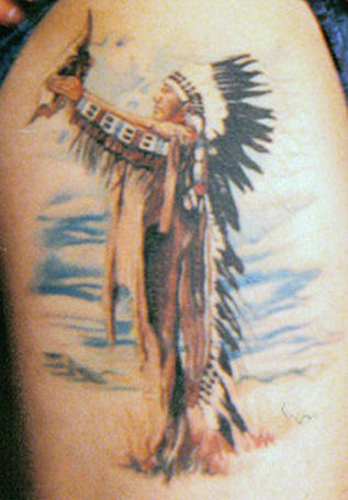 Native American Man With Bird Tattoo On Biceps