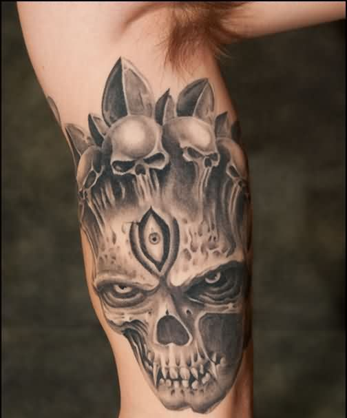 Native American Three Eyed Skull Tattoo On Muscles