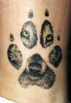 Native American Wolf Face In Paw Tattoo