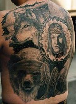 Native American Wolf Woman And Feather Tattoos On Back
