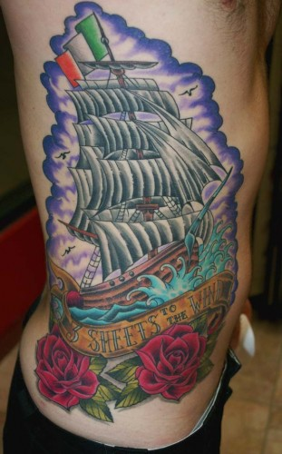 Nautical And Red Rose Tattoos On Full Ribs