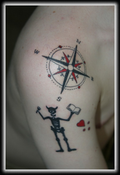 Nautical Compass And Horned Skeleton Tattoos