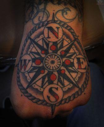 Nautical Compass In Rope Circle Tattoo On Hand
