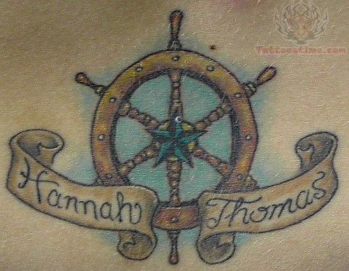 Nautical Star In Center Of Wheel Tattoo