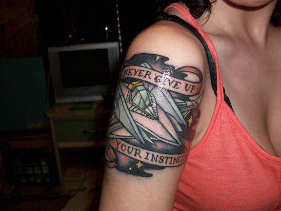 Never Give Up Video Game Tattoo On Below Shoulder