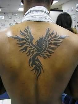 New Dark Black Tribal Phoenix Tattoo On Upperback
