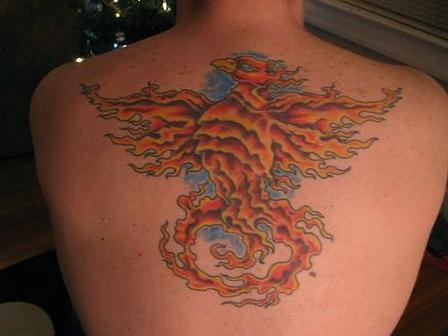 New Flaming Phoenix Tattoo On Upperback