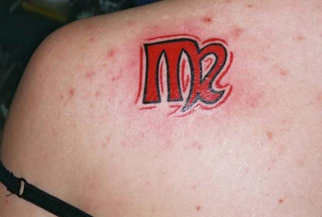 New Red Ink Scorpio Symbol Tattoo Behind Shoulder