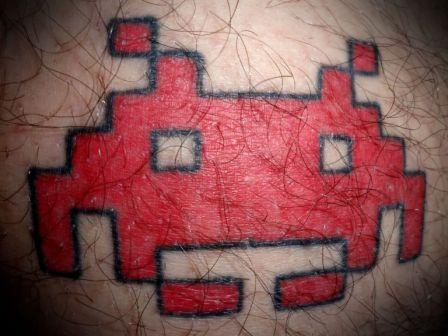 New Red Space Invader Tattoo On Hairy Skin