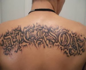 New Style Lettering Tattoo On Upperback