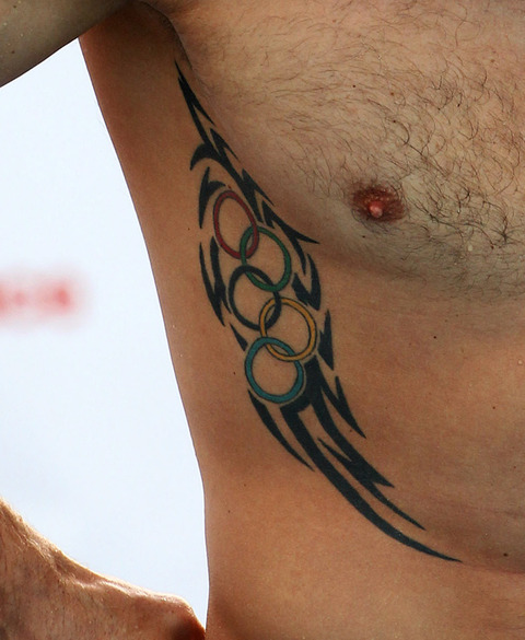New Tribal And Olympic Rings Tattoos